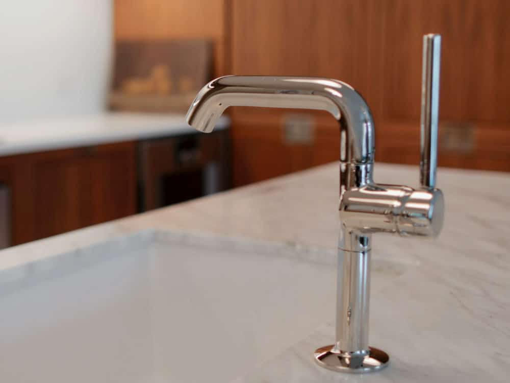 Close up of kitchen faucet, sink and marble countertops in the kitchens at The Hayworth condominiums in New York.