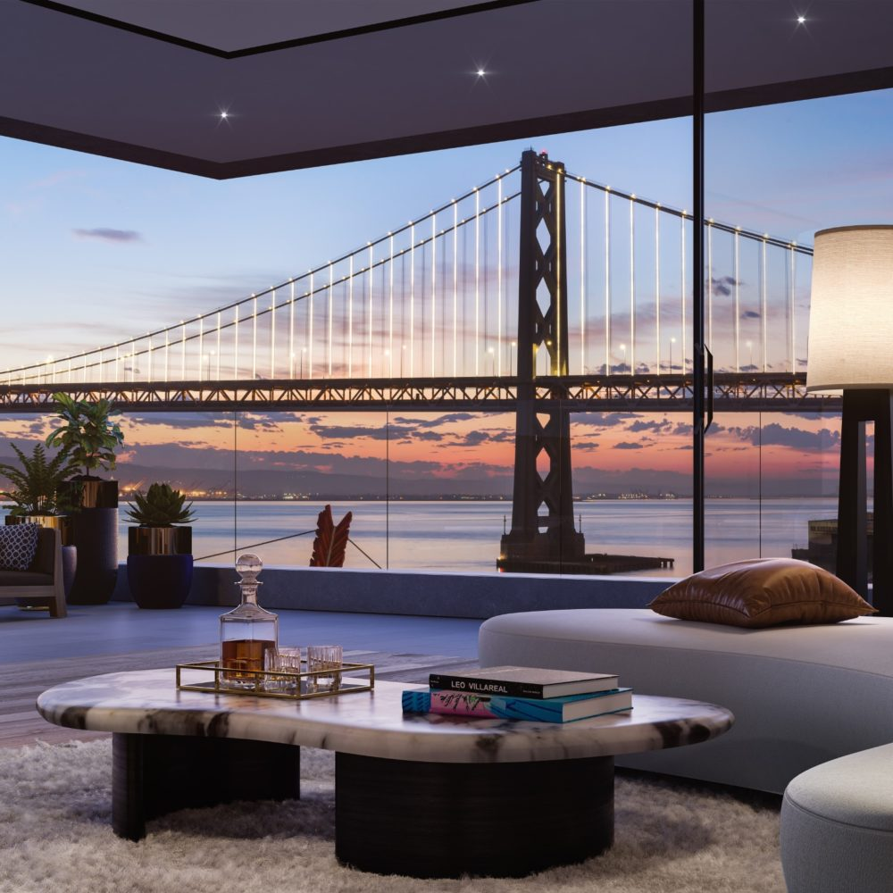 Corner living room with floor-to-ceiling windows and curved couch with views of the Bay Bridge at One Steuart Lane in SF.