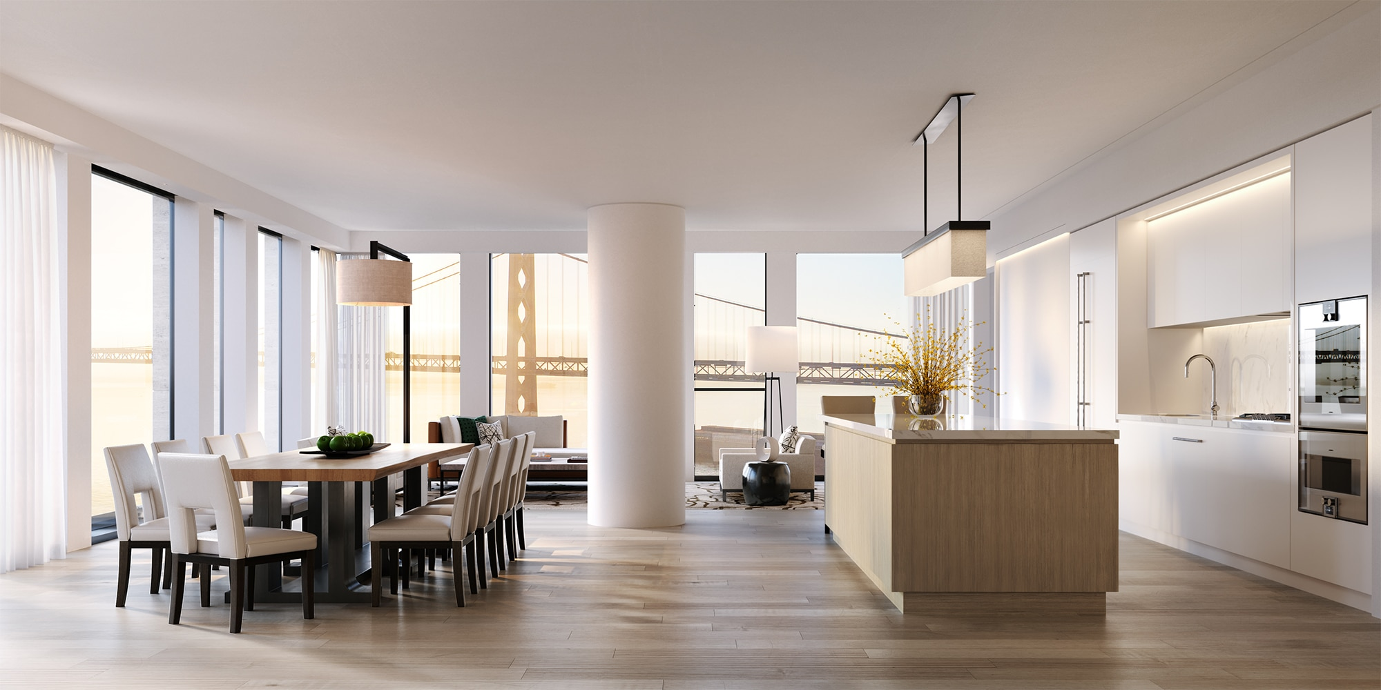 Condo interior at One Steuart Lane in San Francisco. Open layout with kitchen island, dining table and furnished living room.