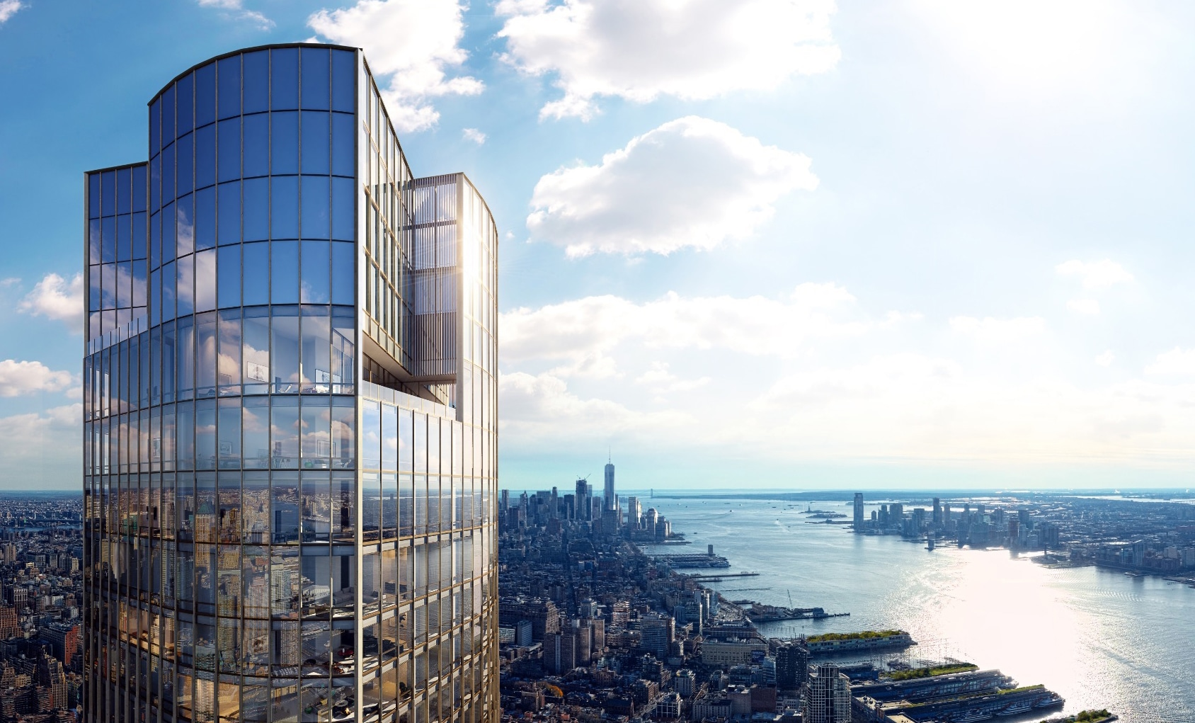 Exterior aerial view of 35 Hudson Yards condominiums with clear blue skies in NYC. Has riverfront view and window paneling.