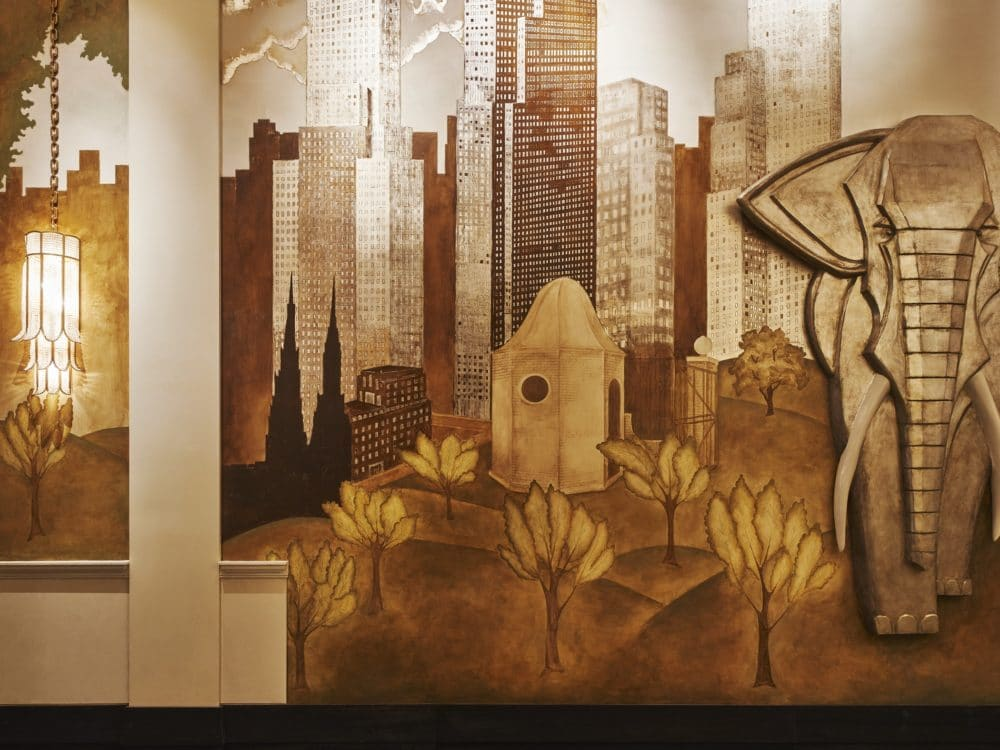 View of detailed mural with gold trim and an elephant inside the lobby of 111 West 57th street condominiums in New York City.