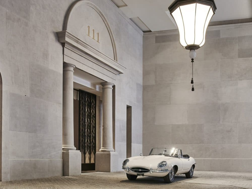 View of a private porte cochere entrance at 111 West 57th street with lots of space and a white car located in New York City.