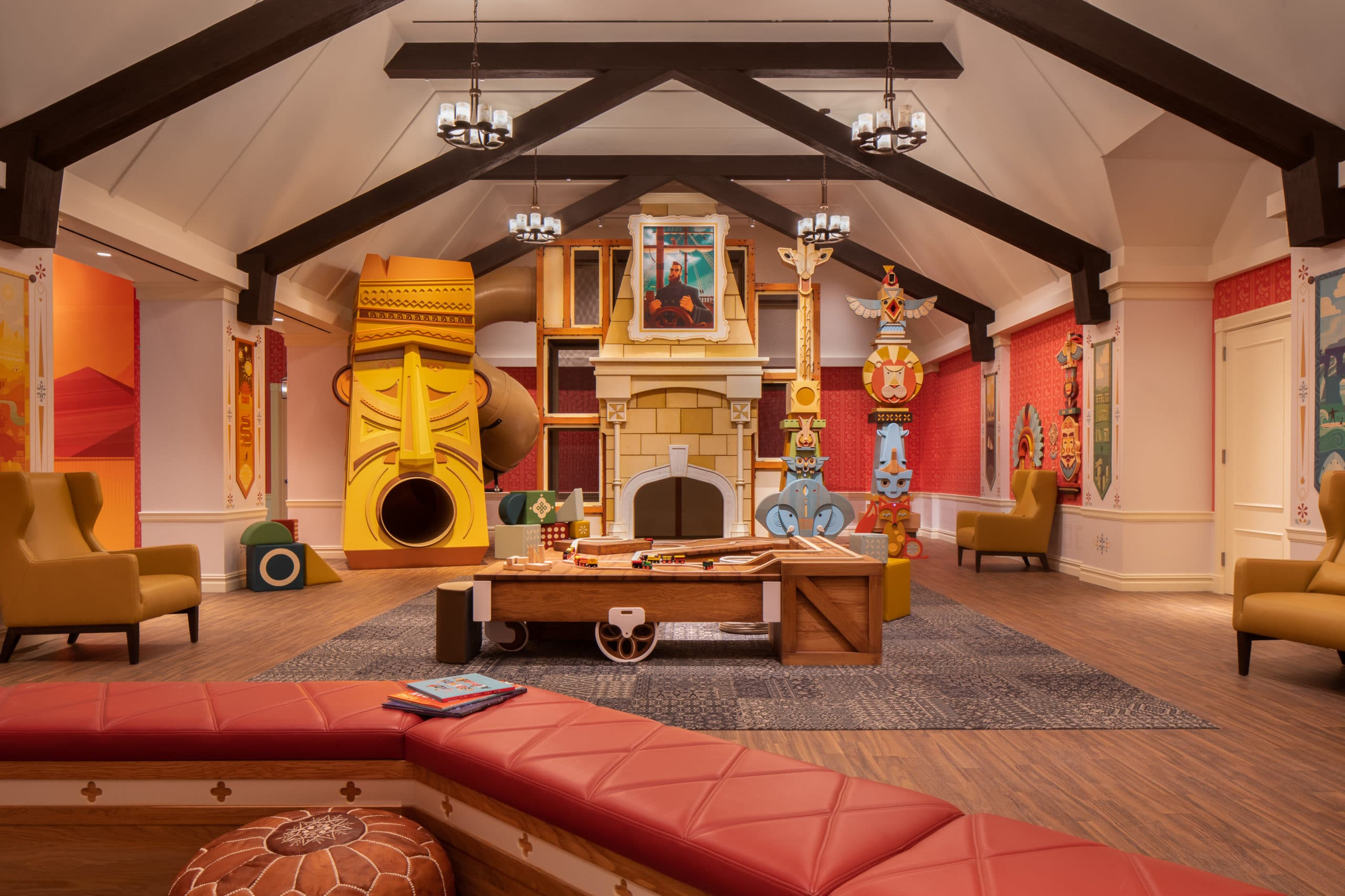 Playroom at Waterline Square luxury condos in New York. Large room with playhouse, slide, and wood brick play area.
