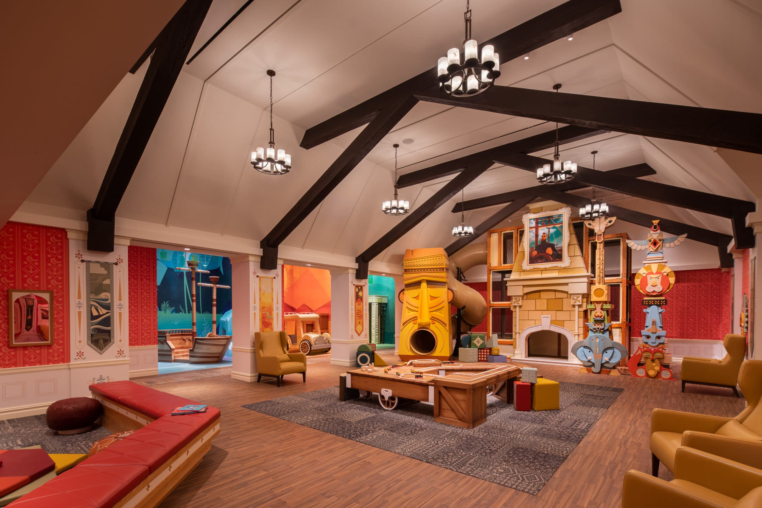 Playroom at Waterline Square luxury condos in New York. Large room with high ceilings, play areas and seating for parents.