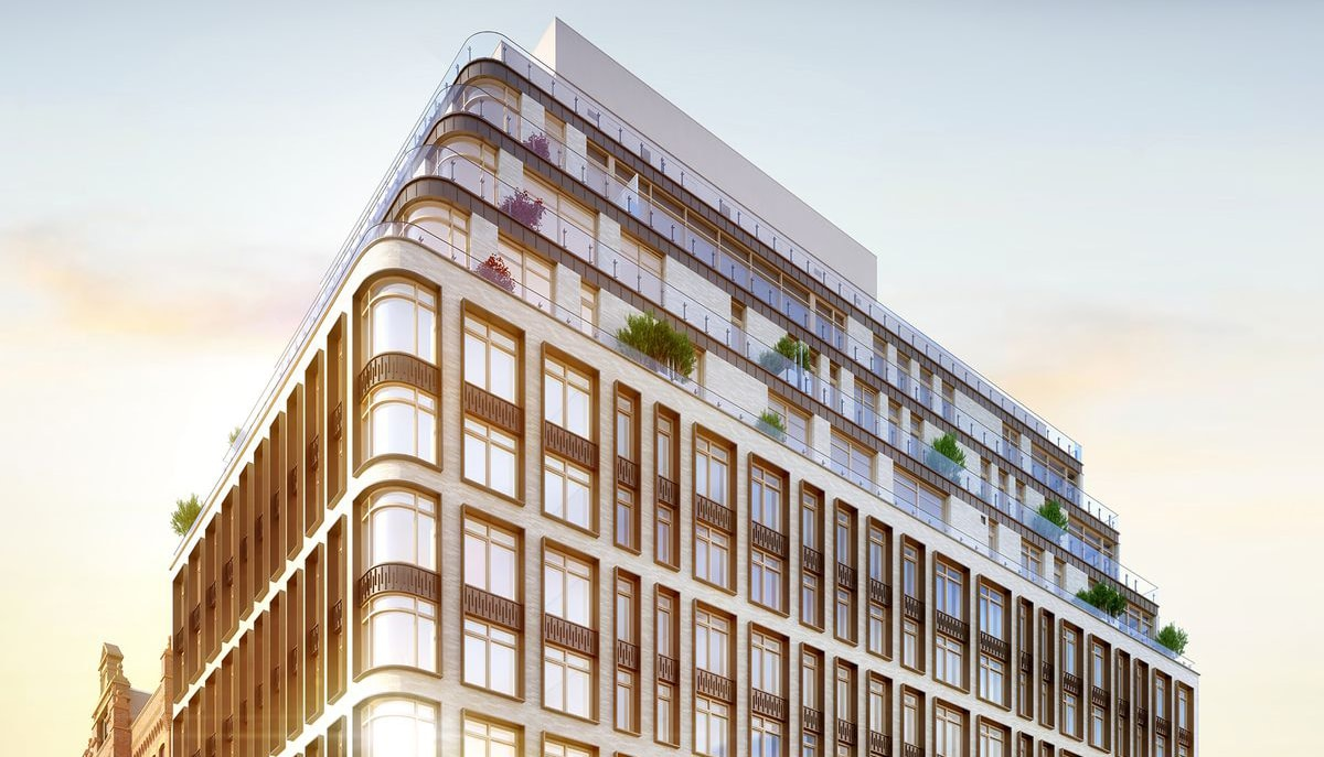 Exterior view of 40 Bleecker condominium in New York. Top floors of NoHo condo with sun reflecting off of large windows.