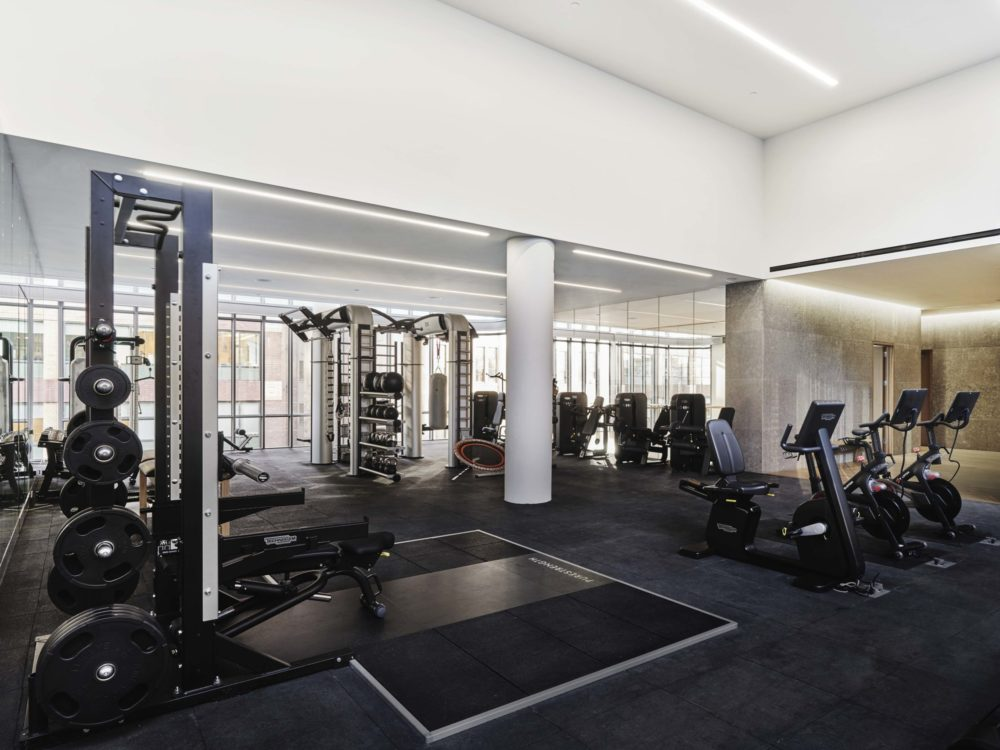 Interior view of 565 Broome residence fitness center in New York City. Has cardio and weightlifting equipment.