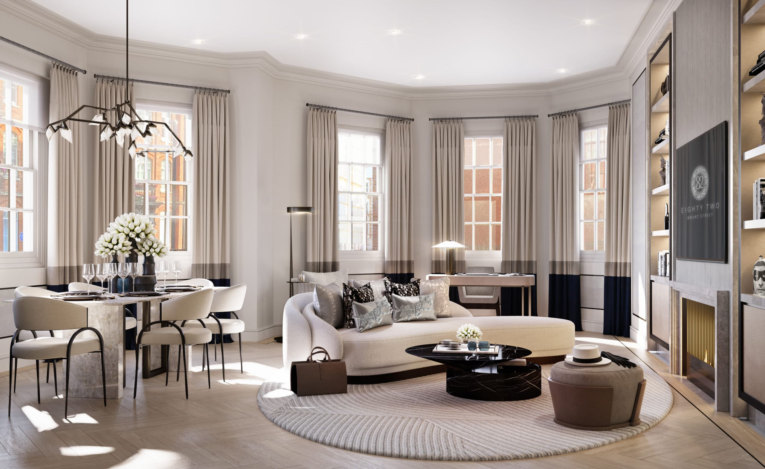 Living room at 82 Mount Street apartments in London. Open room with high ceilings, furniture, fireplace, and dining table.