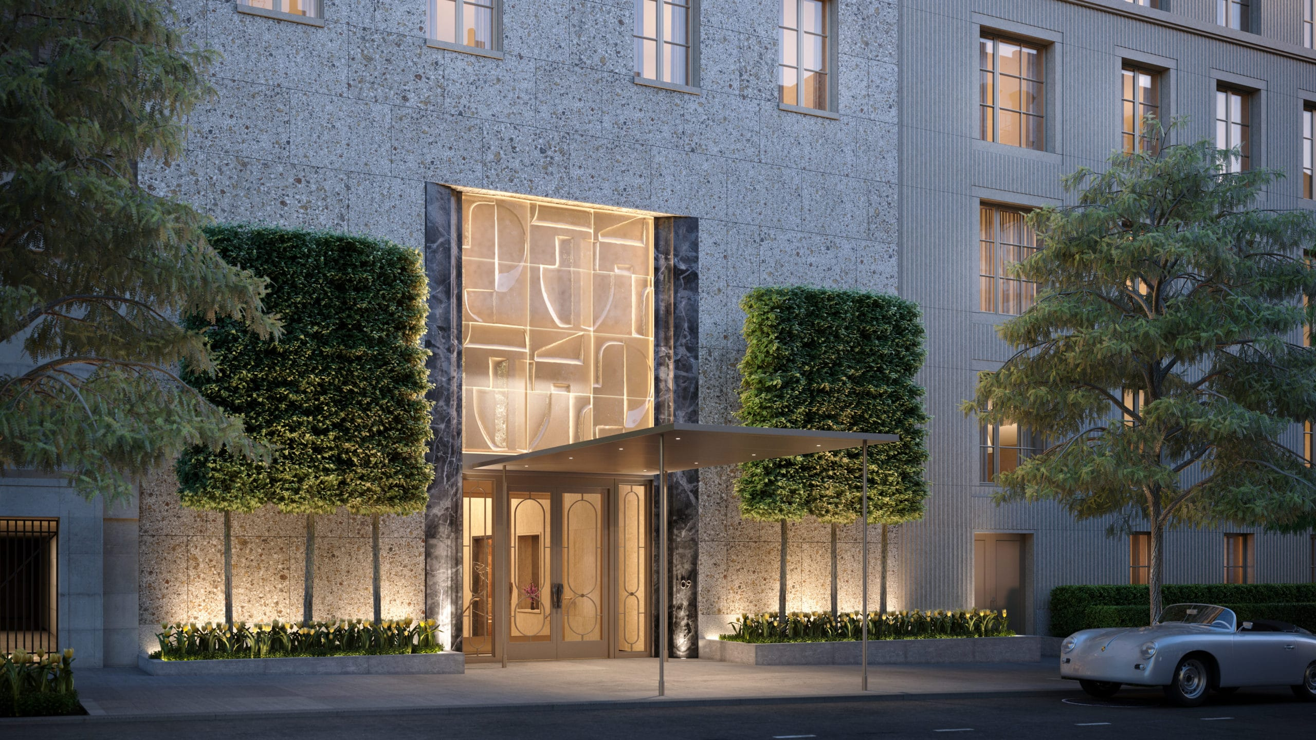 Rendering of entrance to 109 East 79th homes in New York. Entry is framed by marble wings & topped with glass paneling.