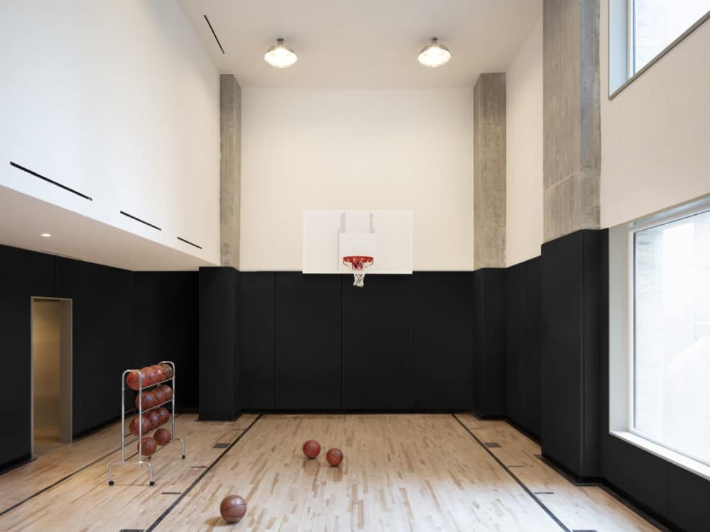 Private basketball court inside 180 E 88th street condominiums located in New York City. Includes basketballs and net.