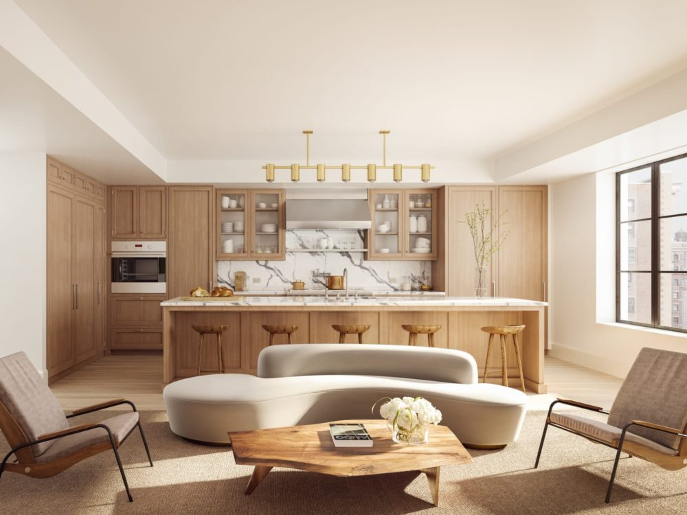 Interior at 555 West End luxury condos in New York. Living room with furniture, the kitchen, white walls, and natural light.